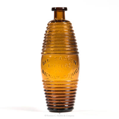 """"""" Old Sachem / Bitters / And / Wigwam Tonic """" Figural Bitters Bottle, R/H # O-46"""